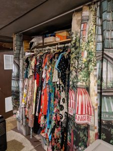 Hidden closet with hanging rod and shelf